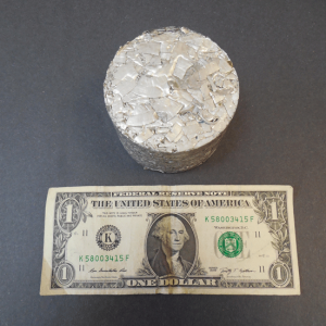 Aluminum-Shaving-Waste-Product-Removed-from-Pipe